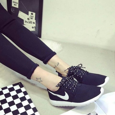Giày nike nữ màu đen phối trắng