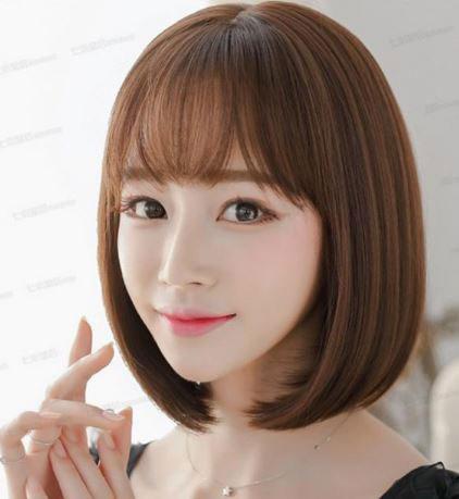 Tóc ngắn mái thưa cho mặt dài